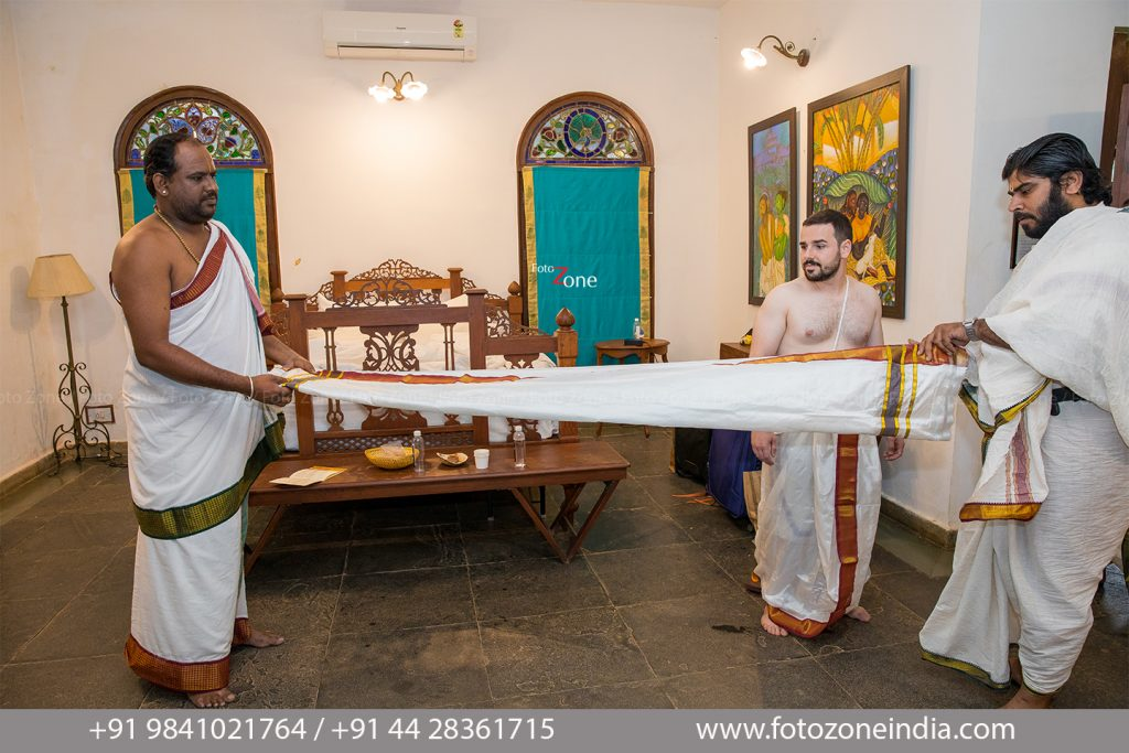 American groom getting ready for Indian tamil brahmin wedding